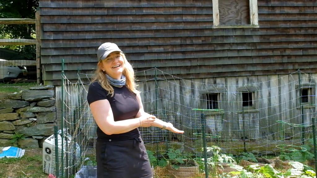 woman standing in front of her home garden