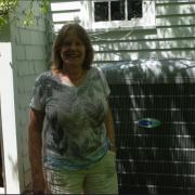 woman by air source heat pump