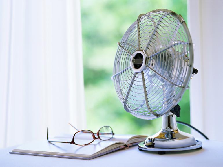 fan sitting in front of window
